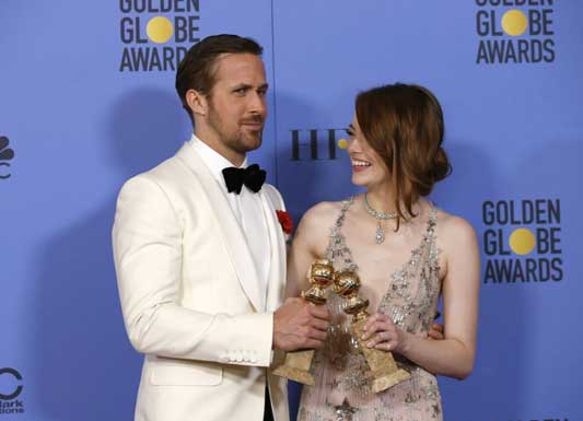 "Ryan Gosling and Emma Stone pose with their awards for Best Performance by an Actor in a Motion Picture - Musical or Comedy and Best Performance by an Actress in a Motion Picture - Musical or Comedy for their roles in ""La La Land""."