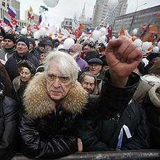 Demonstrators hold a rally protesting against election fraud in Moscow, Saturday, Dec. 24, 2011. Tens of thousands of demonstrators on Saturday cheered opposition leaders and jeered the Kremlin in the biggest show of outrage yet against Prime Minister Vla