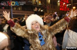 A woman takes part in the Hogmanay (New Year) street party celebrations in Edinburgh, Scotland, January 1, 2014. (REUTERS/Russell Cheyne)
