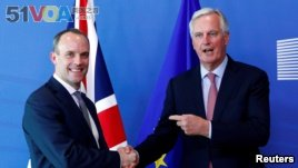 Britain's Secretary of State for Exiting the European Union, Dominic Raab and the European Union's chief Brexit negotiator, Michel Barnier, at a meeting in Brussels, Belgium, July 19, 2018.