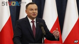 FILE - Poland's President Andrzej Duda speaks at a news conference in Warsaw, Poland, Dec. 20, 2017.