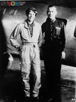 Famed aviator Amelia Earhart and her navigator, Fred Noonan, pose in this file photo in front of their twin-engine Lockheed Electra in Los Angeles at the end of May, 1937. (AP Photo, File)