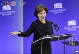 Former first lady Laura Bush speaks at a forum sponsored by the George W. Bush Institute in New York, Oct. 19, 2017.