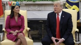 President Donald Trump meets with outgoing U.S. Ambassador to the United Nations Nikki Haley in the Oval Office of the White House, Tuesday, Oc. 9, 2018, in Washington. (AP Photo/Evan Vucci)